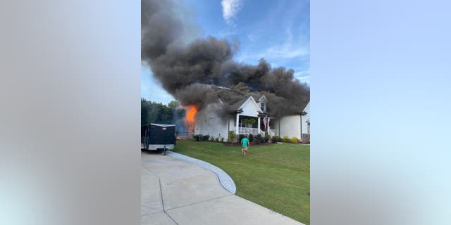 Sean Matthews and Kellie Stanley rushed home while neighbors worked to rescue their 13-year-old dog Memphis. A fire had spread from their front porch to the rest of their home.