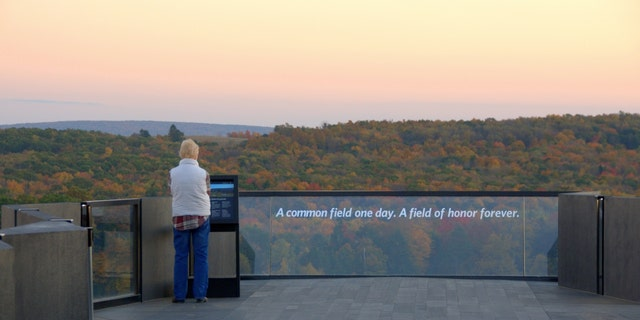 A visitor stands at the Flight 93 Memorial