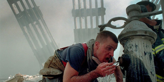 Woodmere Long Island Volunteer Firefighter Michael Sauer drinks from a fire hydrant on 9/11/01.