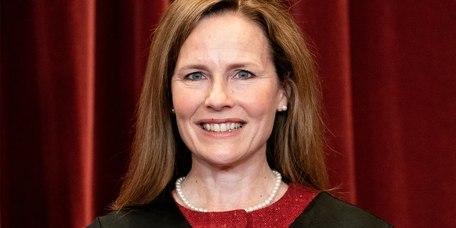 Associate Justice Amy Coney Barrett poses during a group photo of the justices at the Supreme Court in Washington, April 23, 2021. (Erin Schaff/Pool via REUTERS)