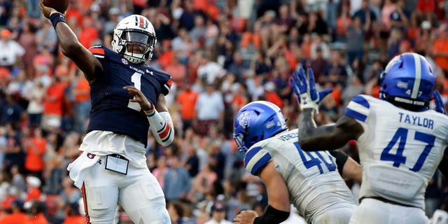 Auburn quarterback TJ Finley (1) throws a pass for a touchdown to take the lead over Georgia State in the final minute of the second half of an NCAA football game Saturday, Sept. 25, 2021, in Auburn, Ala.