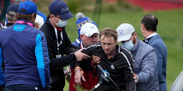 Actor Tom Felton is helped after collapsing at the Ryder Cup.