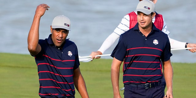 Team USA's Tony Finau reacts after making a putt on the 13th hole during a four-ball match the Ryder Cup at the Whistling Straits Golf Course Friday, Sept. 24, 2021, in Sheboygan, Wis.