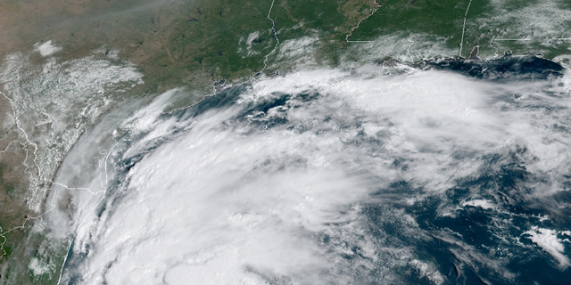 This satellite image provided by NOAA shows Tropical Storm Nicholas in the Gulf of Mexico.