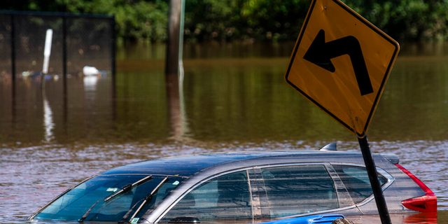 A car flooded on a local street as a result of the remnants of Hurricane Ida is seen in Somerville, N.J. Thursday, Sept. 2, 2021.