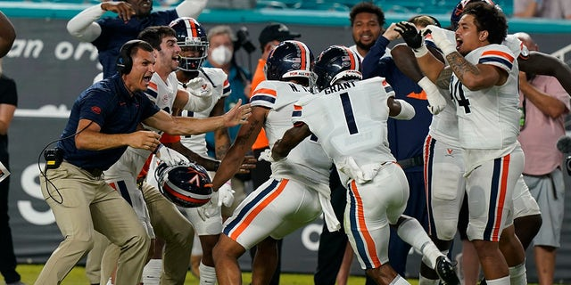 Virginia celebrates after scoring a safety during the first half of a NCAA college football game against Miami, Thursday, Sept. 30, 2021, in Miami Gardens, Fla.