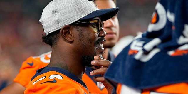 Denver Broncos outside linebacker Von Miller watches from the sidelines during the second half of an NFL preseason football game against the Los Angeles Rams, Saturday, Aug. 28, 2021, in Denver. (AP Photo/Jack Dempsey)