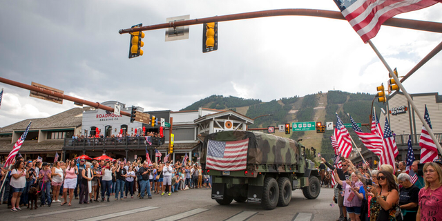 Community members honor Marine Lance Cpl. Rylee McCollum during a procession in Jackson, Wyo., Friday, Sept. 10, 2021.