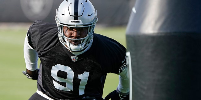 In this uesday, June 15, 2021, file photo, Las Vegas Raiders defensive end Yannick Ngakoue takes part in a drill during an NFL football practice in Henderson, Nev. The Raiders bolstered the pass rush with the addition of edge rusher Ngakoue and defensive tackle Quinton Jefferson and added help in the secondary in veteran cornerback Casey Hayward and rookie safety Tre'von Moehrig. (AP Photo/John Locher, File)