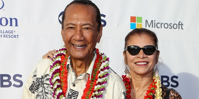 Al Harrington (L) and his wife attend the Sunset On The Beach event celebrating the 10th season of 'Hawaii Five-0' and season 2 of 'Magnum P.I.' at Queen's Surf Beach on September 19, 2019 in Waikiki, Hawai. (