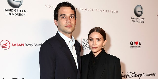 (L-R) Louis Eisner and Ashley Olsen attend an event in Los Angeles, California.