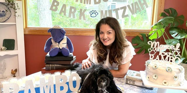 """Rambo's """"Bark Mitzvah"""" was outfitted with personalized decor. The 13-year-old Havenese pup also received special dog-sized attire and peanut butter cake. Here he sits with his owner Ruth Ellenberg."""