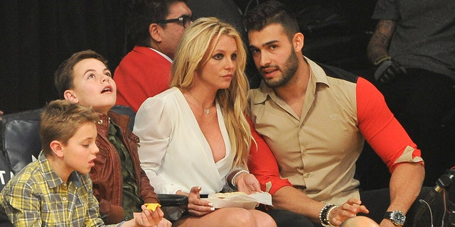 Sean Federline, Jayden James Federline, Britney Spears and Sam Asghari attend a basketball game between the Los Angeles Lakers and the Golden State Warriors at Staples Center on November 29, 2017 in Los Angeles, California.