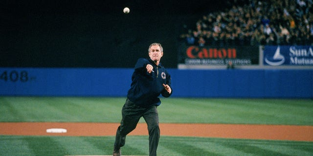 President George W. Bush throws the ceremonial first pitch before the third game of the 2001 World Series between the Arizona Diamondbacks and the New York Yankees at Yankee Stadium on October 30, 2001 in Bronx, New York.  The Yankees defeated the Diamondbacks 2-1.  (Photo by Rich Pilling / MLB via Getty Images)