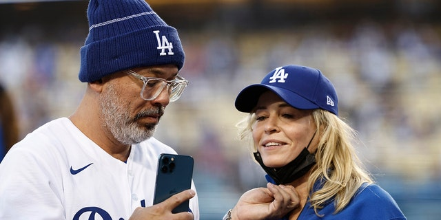 Comedian Jo Koy (L) and comedian/actress Chelsea Handler (R) take a selfie at a Los Angeles Dodgers game.