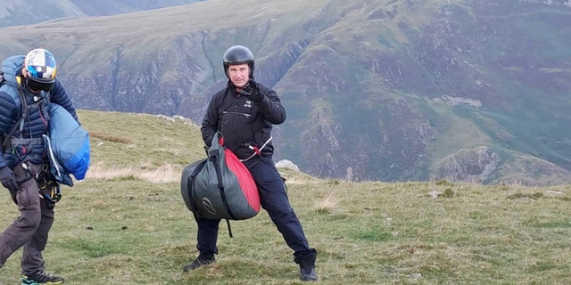 Tom Cruise landed his helicopter in England's Lake District and surprised some hikers.