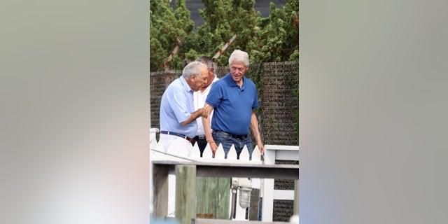 Pictured: Bill Clinton,Alfonso Fanjul Ref: SPL5250460 310821 EXCLUSIVE Picture by: Matt Agudo / SplashNews.com
