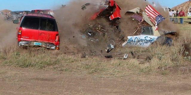 John Smith, known as the Flying Farmer, crashed his Chevrolet Caprice while attempting a jump in Makoti, N.D.