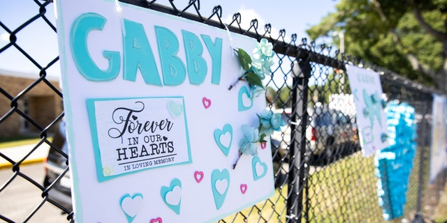 A sign is seen during Gabby Petito's memorial service in Holbrook, New York, U.S., September 26, 2021.
