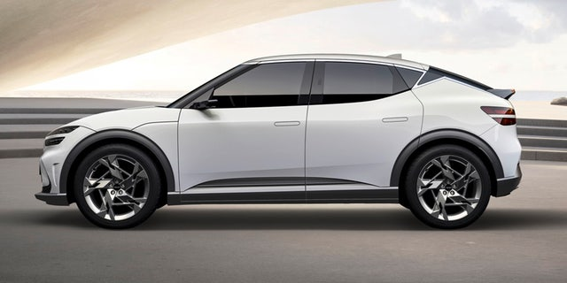 The Genesis GV60 electric vehicle features a chrome strip of trim along its roofline that's shaped like a lightning bolt.