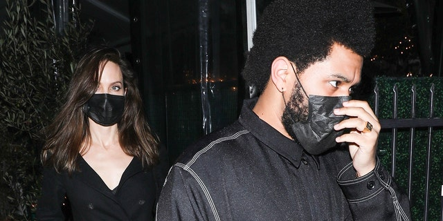 Angelina Jolie (L) and The Weeknd (R) dined together at Giorgio Baldi.