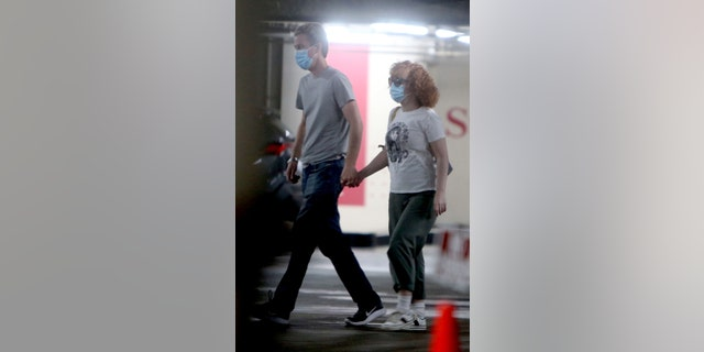 The comedian is spotted running errands, holding hands with her spouse who she married in 2020.