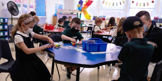 Sept. 7, 2021: Students at a Catholic elementary school on the first day of classes in Boston, Massachusetts. Students are returning to in-person learning, despite the Bay State seeing a rise in coronavirus cases.