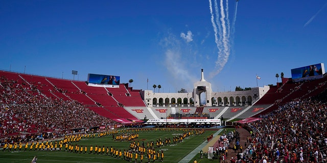 Airplanes fly over Los Angeles Memorial Coliseum before an NCAA college football game between San Jose State and Southern California Saturday, Sept. 4, 2021, in Los Angeles. (AP Photo/Ashley Landis)