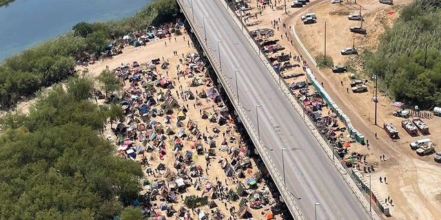 Sept. 18, 2021: Migrants camp under the International Bridge in Del Rio. [Rep. Pfluger.)