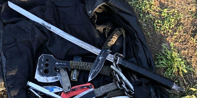 Police said they found the suspect in possession of 15 weapons, including a sword, ax, several knives and a slingshot.