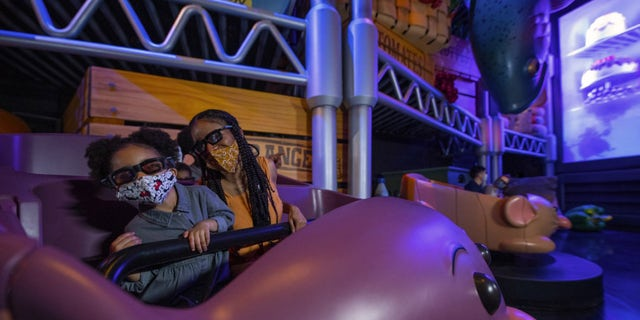 """The new attraction promises to shrink riders down to the size of Cher Remy on """"a thrilling chase through Gusteau's restaurant."""