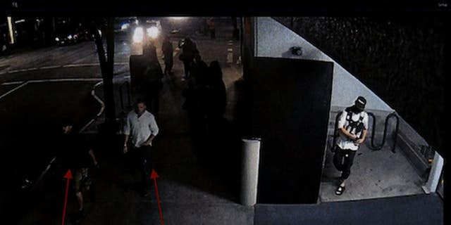 Security camera footage from Aug. 29, 2020, shows Michael Reinoehl in an alcove of a Portland, Oregon, parking garage while Aaron Danielson and a friend walk by, according to police.(Portland Police Bureau)
