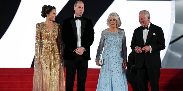 Britain's Prince Charles (R), his wife Camilla the Duchess of Cornwall, Kate the Duchess of Cambridge (L) and her husband Britain's Prince William pose for photographers upon arrival for the world premiere of the new film from the James Bond franchise 'No Time To Die' in London.