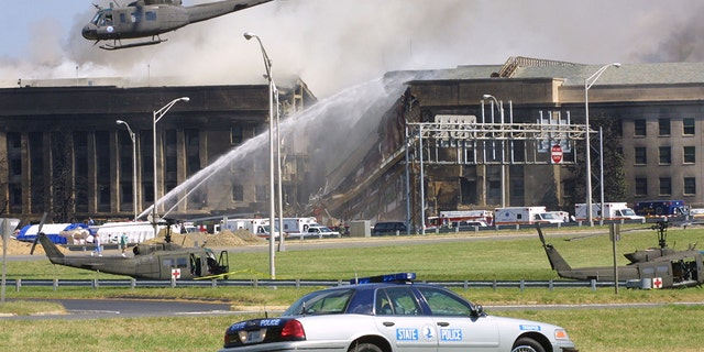 Smoke comes out from the Southwest E-ring of the Pentagon building Sept. 11, 2001 in Arlington, Virginia, after a plane crashed into the building and set off a huge explosion.