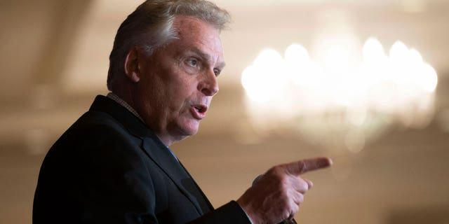 In this Wednesday, Sept. 1, 2021, file photo, Virginia Democratic gubernatorial candidate Terry McAuliffe addresses the Virginia FREE Leadership Luncheon in McLean, Virginia. (AP Photo/Cliff Owen, File)