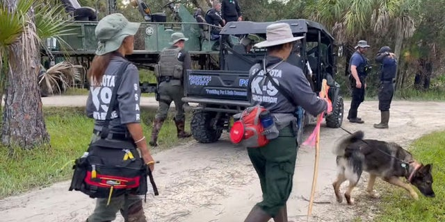Search teams are deployed at the Carlton Reserve near North Port, Fla., on Wednesday.