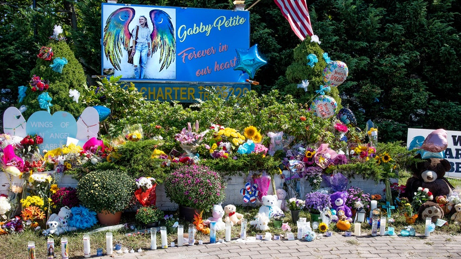Members of the public leave flowers at a memorial site for Gabby Petito, September 26, 2021 in Blue Point, Long Island, New York
