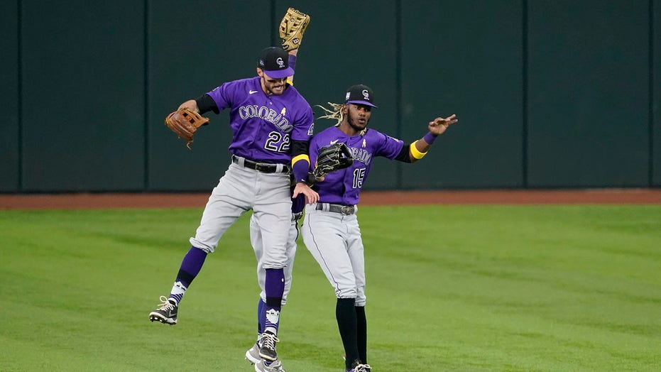 Rockies fall behind early, score 5 in 9th to beat Rangers