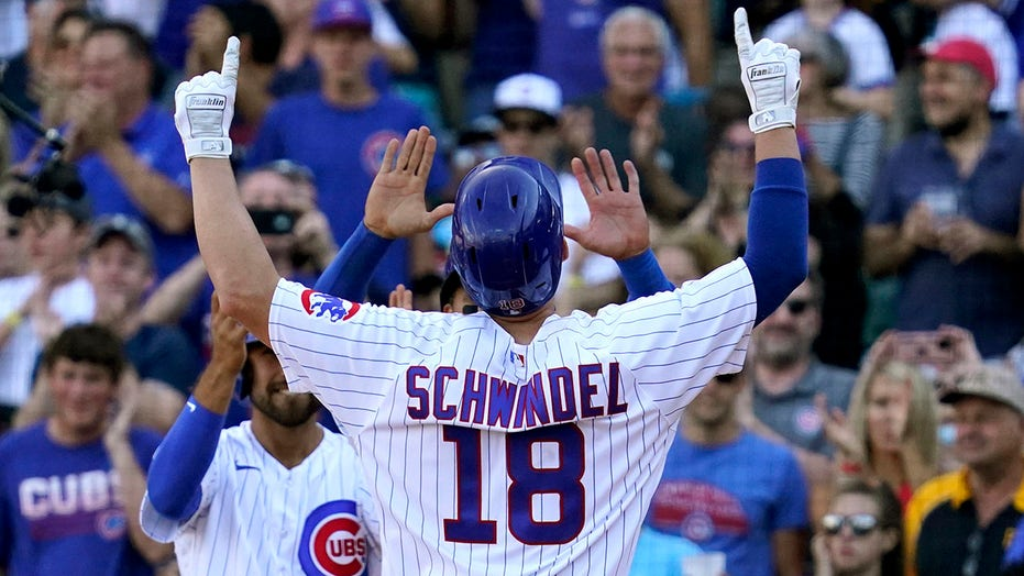 Schwindel's grand slam lifts Cubs over Pirates 11-8