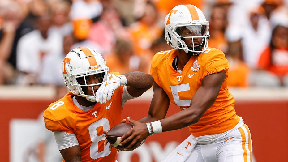 Hooker in on 4 TDs, leads Tennessee to easy win, 56-0