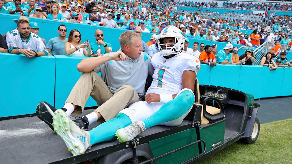 Dolphins' Tua Tagovailoa carted off the field with rib injury after taking big hit