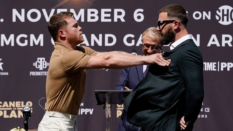 Canelo Álvarez, Caleb Plant throw punches at news conference promoting upcoming fight