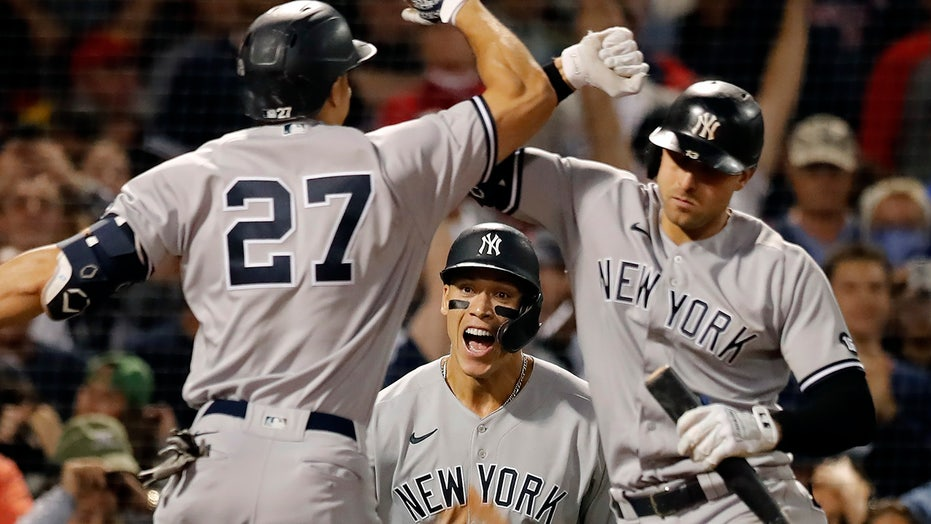 Yankees top Red Sox after controversial 8th inning, take over wild-card lead