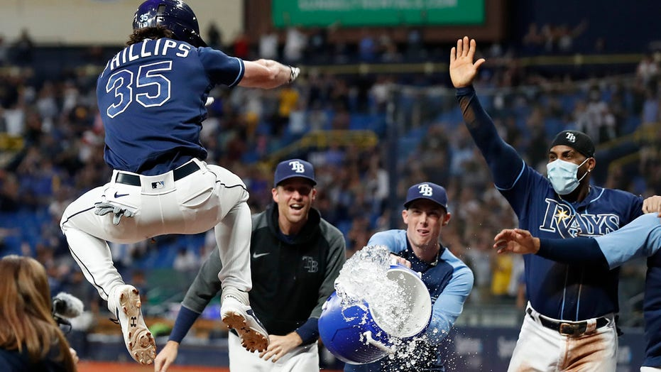 Phillips homers in 10th as Rays rally to beat Tigers 7-4