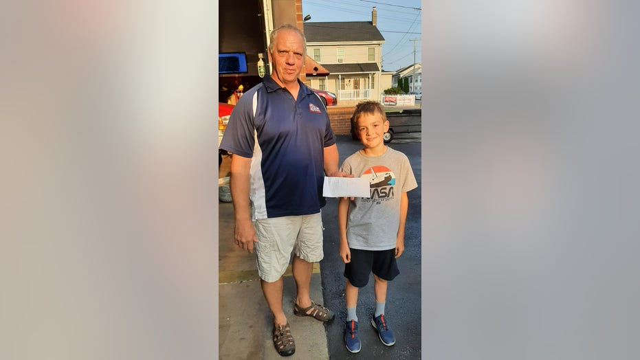 8-year-old holds lemonade stand to raise money for a real-life fire truck for his community