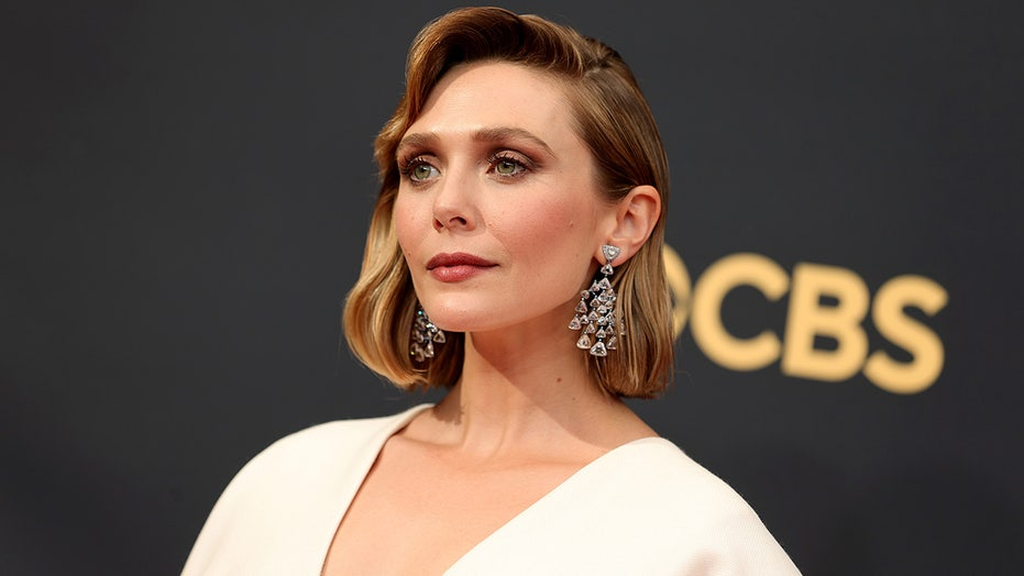 Elizabeth Olsen hits Emmys red carpet in dress designed by sisters Mary-Kate and Ashley Olsen