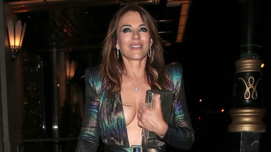 Elizabeth Hurley, 56, rocks a plunging low-cut cocktail dress to celebrate David Walliams' 50th birthday