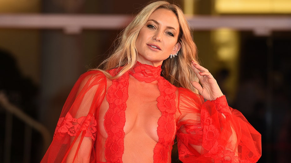 Kate Hudson stuns in sheer red dress after modeling the 'ovary cutout' at the Venice Film Festival