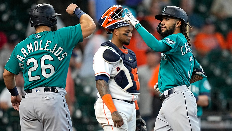 Marmolejos, Mariners score 4 in 9th, avoid sweep by Astros