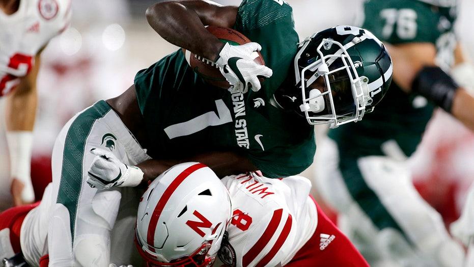 OT interception lifts No. 20 Spartans over Nebraska 23-20
